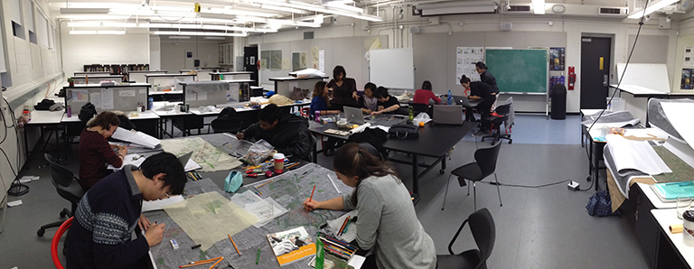 UBC Urban Design students work in the MacMillan Building studio on work to be presented in Surrey. Photo Credit: UBC SALA